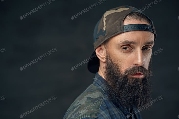 Bearded male in military cap.