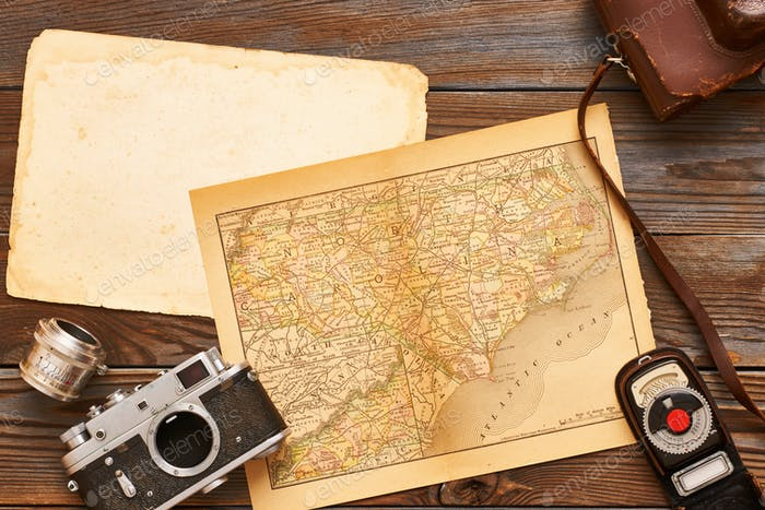 Vintage cameras and lenses on antique XIX century map