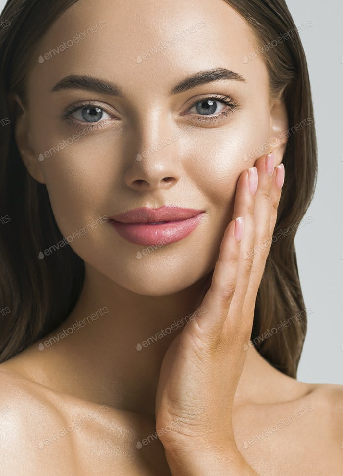 Young beautiful cosmetic model healthy skin face