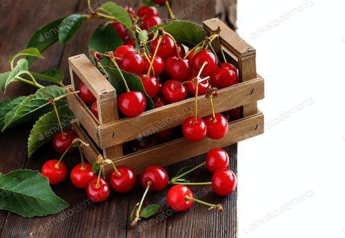 Fresh sour cherries in bowls on a wooden table