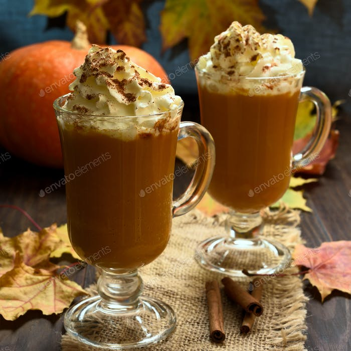 Pumpkin latte with whipped cream and cinnamon