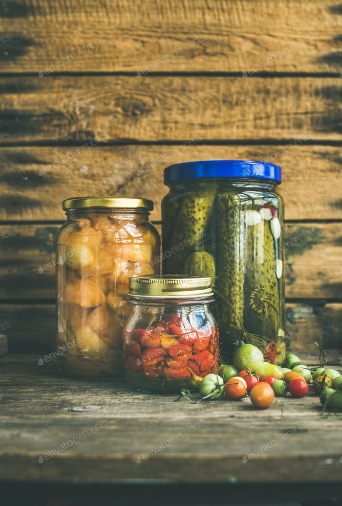 Autumn pickled vegetables in glass jars, copy space