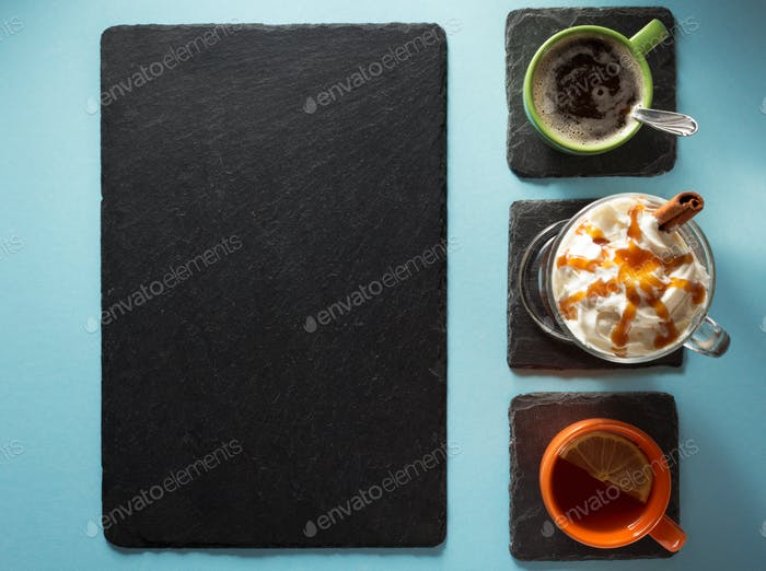 cup of coffee and tea at abstract background