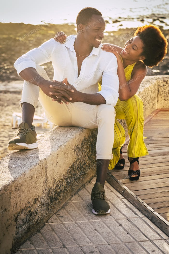 Black young people couple enjoy together leisure outdoor activity with beach in background