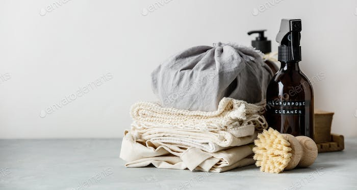 Zero waste beauty body care and house cleaning items on color paper background