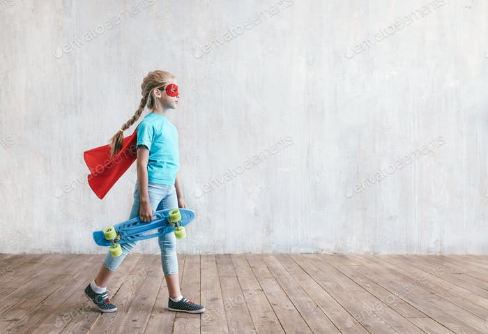 Little super girl with a skateboard