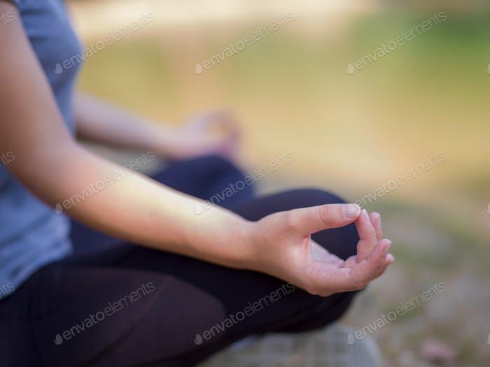 woman meditating and doing yoga exercise