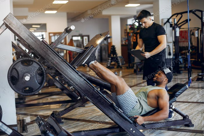 A two handsome men is engaged in a gym