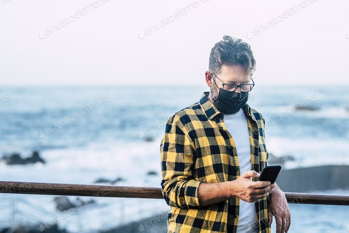 Portrait of adult man outdoor wearing facial protection mask for coronavirus covid-19 outbreak
