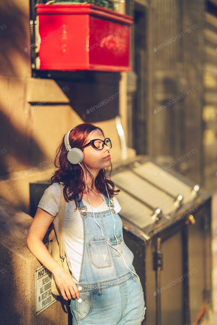 Young girl in headphones in New York City