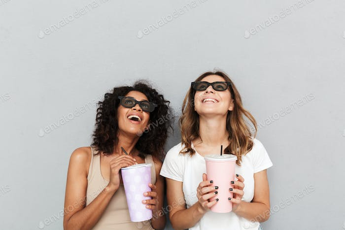 Portrait of two smiling young women in 3d glasses
