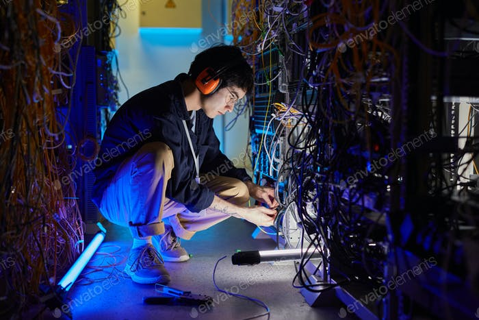 Asian Man Working with Network Server