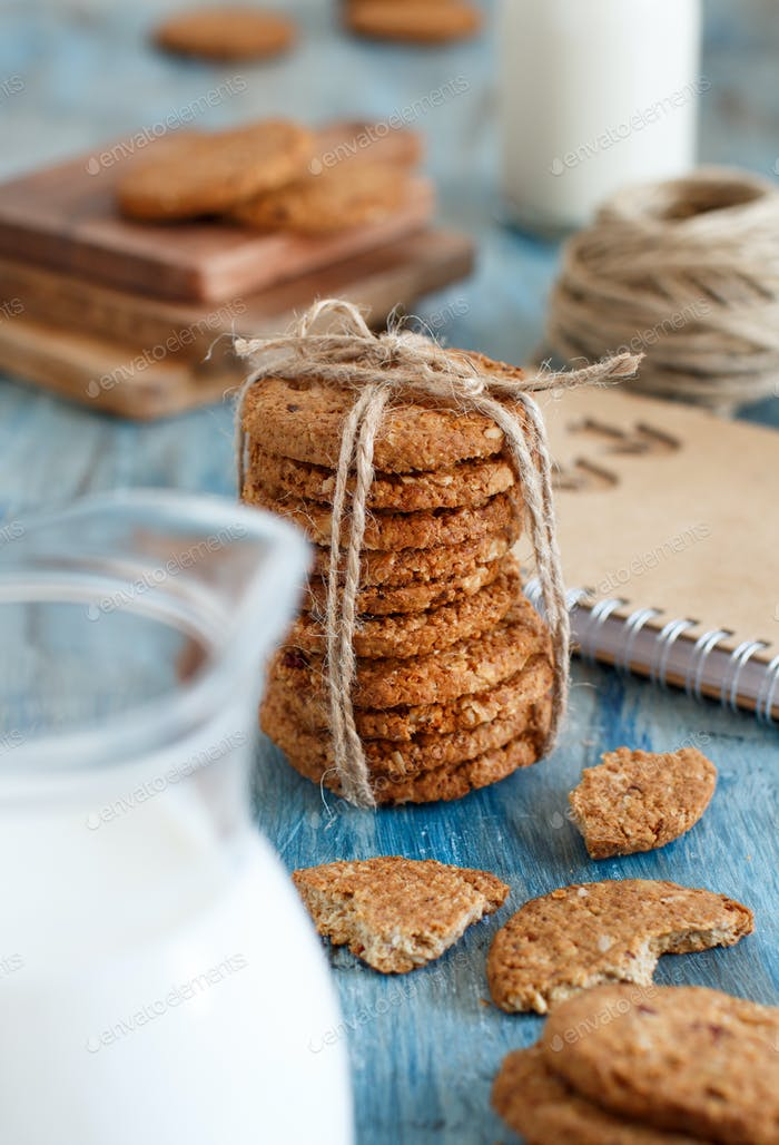 Homemade oatmeal cookies with milk close up