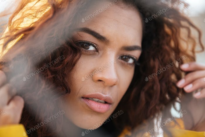 Concentrated african curly young lady