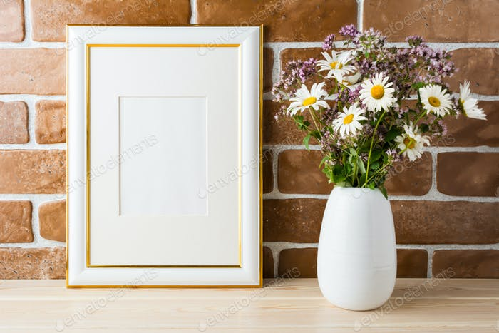 Gold decorated frame mockup with wildflowers bouquet exposed bri