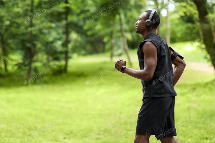 Profile photo of african man jogger training at park