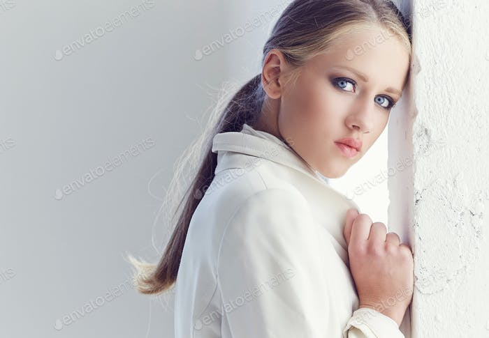 Portrait of blond female with blue eyes.