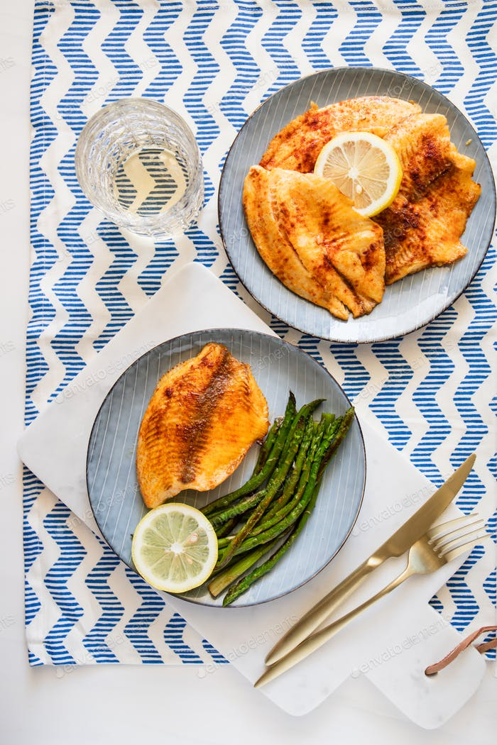 Baked tilapia fish with asparagus