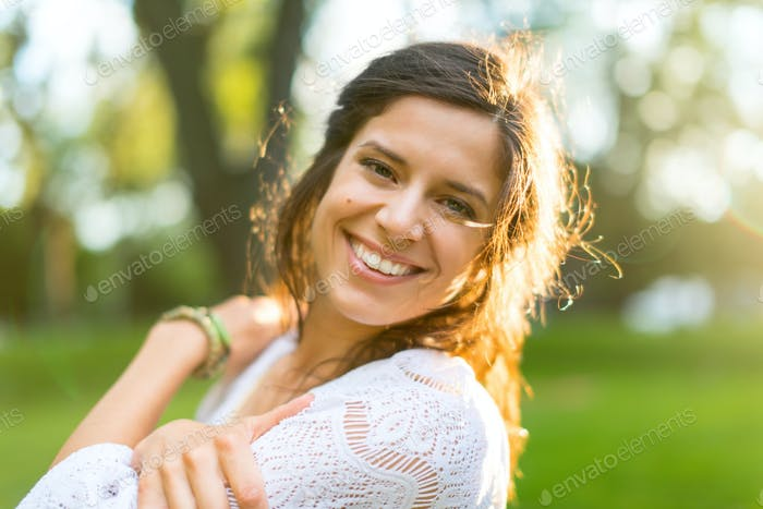 Multi-ethnic girl enjoying the warmth of a sunset