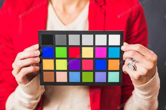 Crop woman with color board