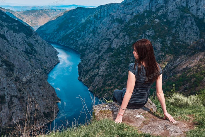 Young woman contemplating the Sil Canyons in Ourense, Spain