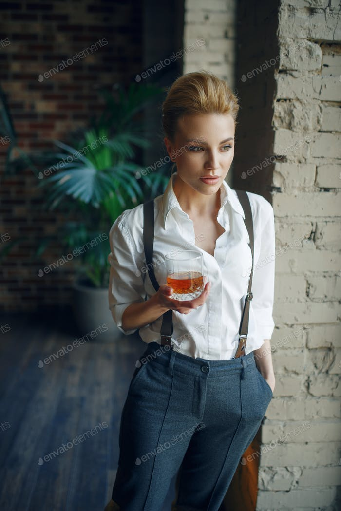 Woman holding glass of whiskey, retro fashion