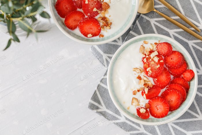 Top view on two bowls with coconut yoghurt