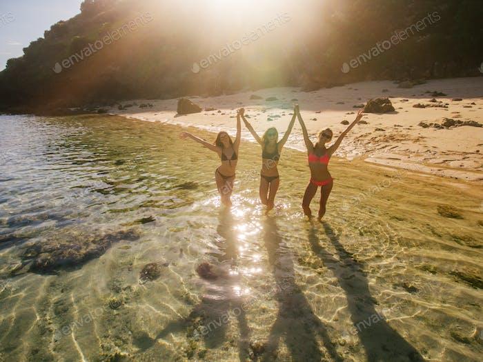 Three women having fun on beach vacation