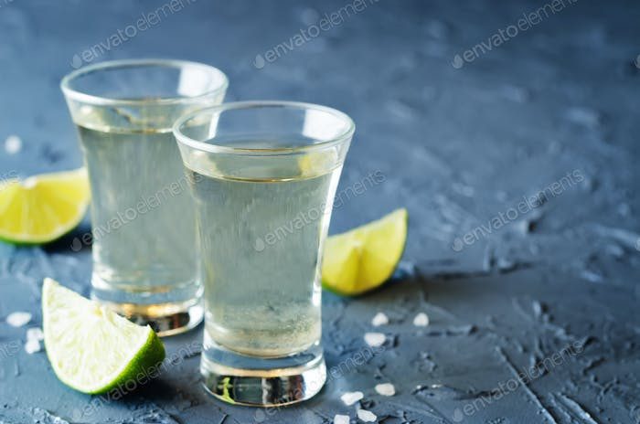 Tequila in glasses with lime and salt