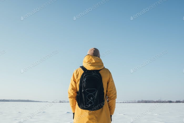 Alone traveler in yellow jacket