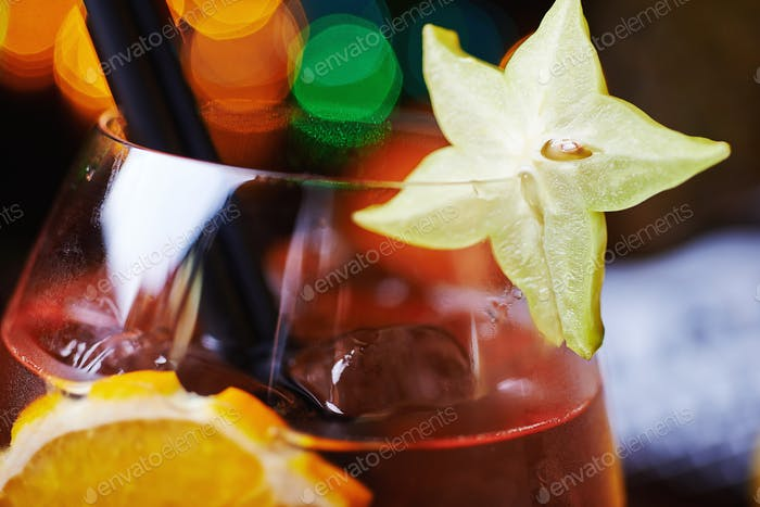 tropical alcohol cocktail or lemonade with decoration.
