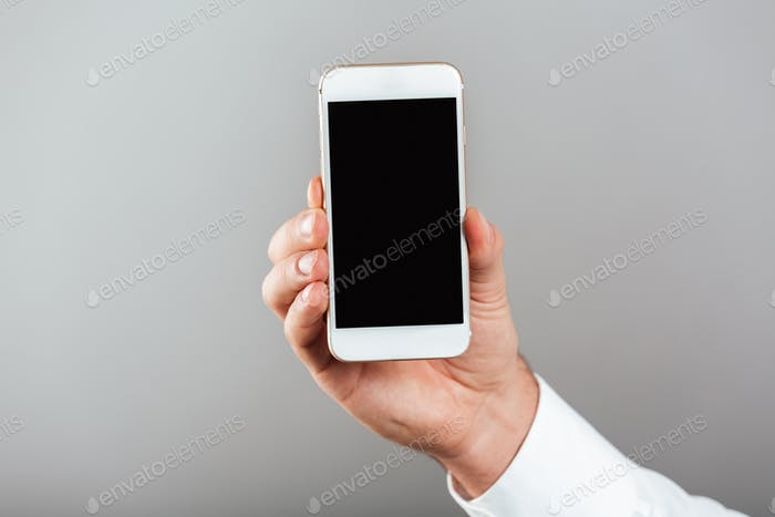 Close up of man showing blank screen mobile phone