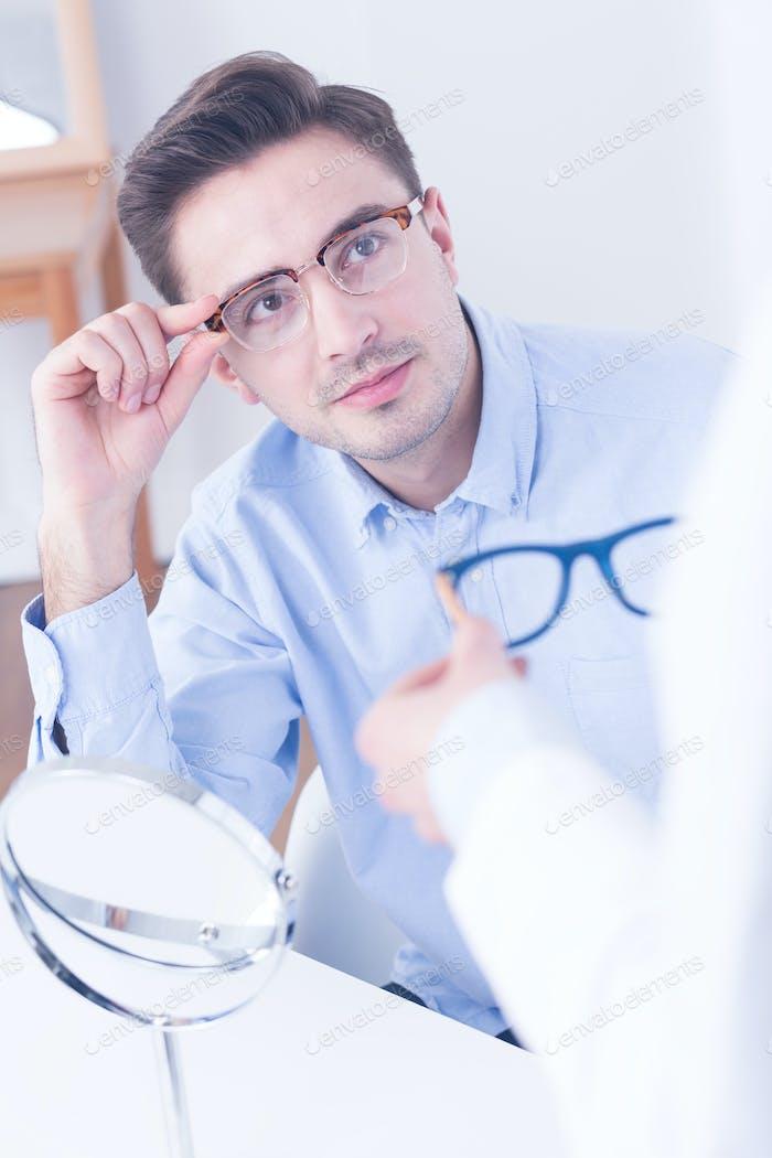 Man trying on new eyeglasses