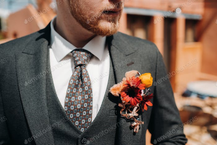 Groom in a jacket and boutonniere close-up.Groom close-up in Provence, France, the groom's fees