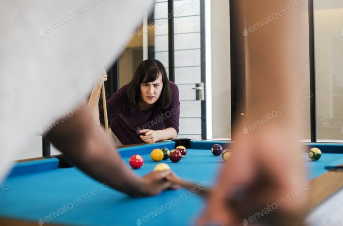 Rivalry couple playing a game of pool