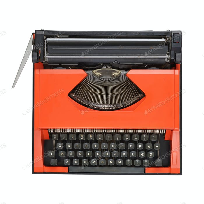 Red manual typewriter isolated