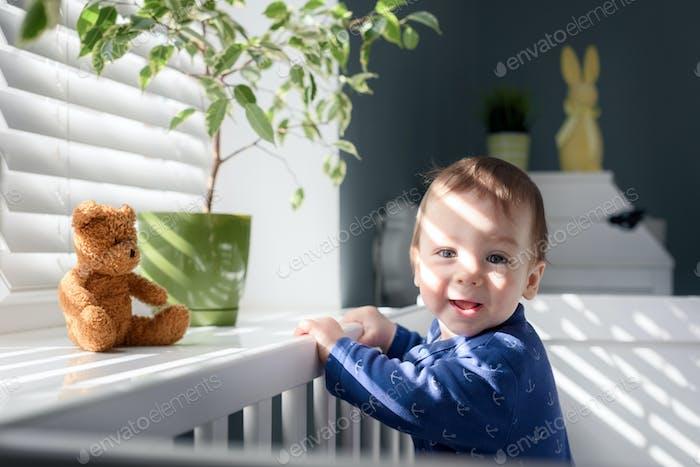 Smiling boy near window