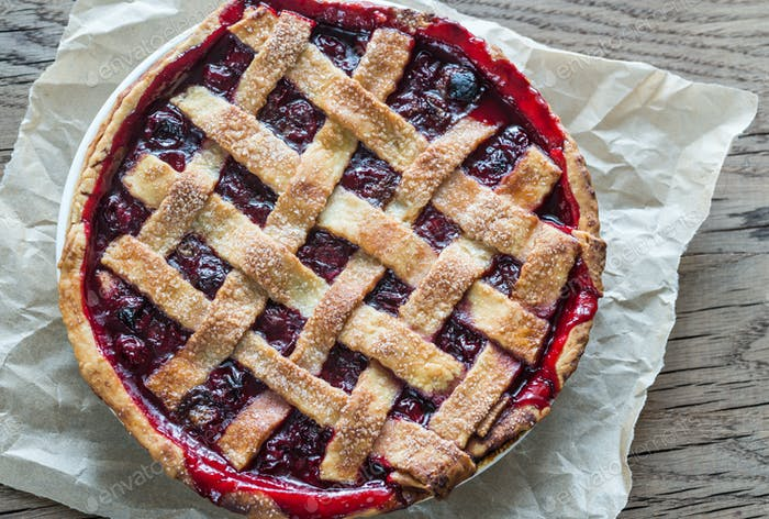 Cherry pie on the wooden background