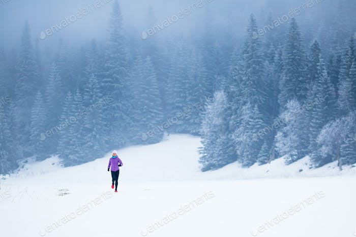 Winter running woman, jogging inspiration and motivation