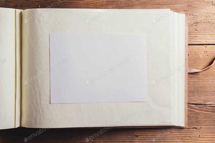 Photo album on wooden desk