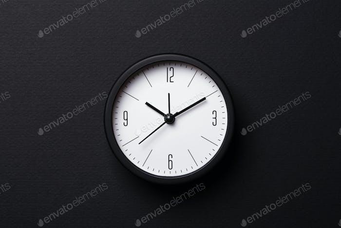 Modern Black Alarm Clock on Black Background.