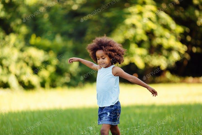 Portrait of little girl walking in nature
