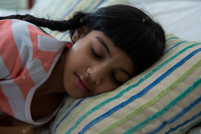 Close-up of girl sleeping on bed