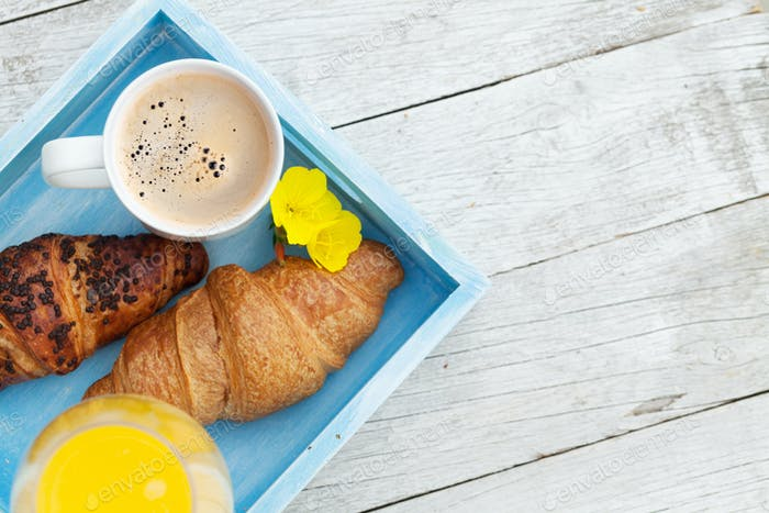 Coffee, orange juice and croissant