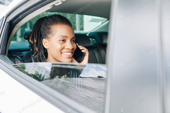 Passenger using phone in car