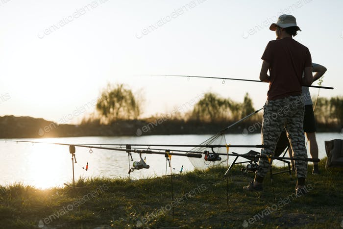 Fishing as recreation and sports displayed by fisherman at lake