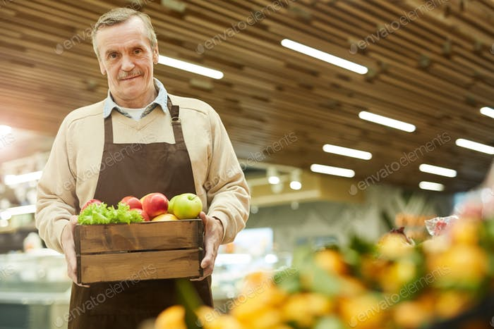 Senior Man Holding Box of Delicious Apples