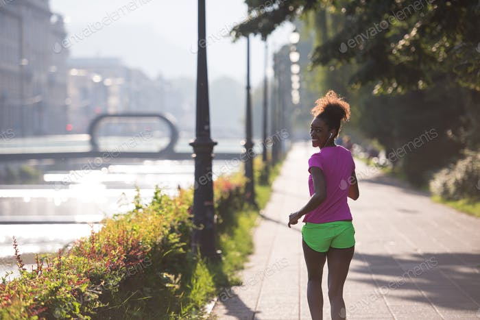 african american woman jogging in the city