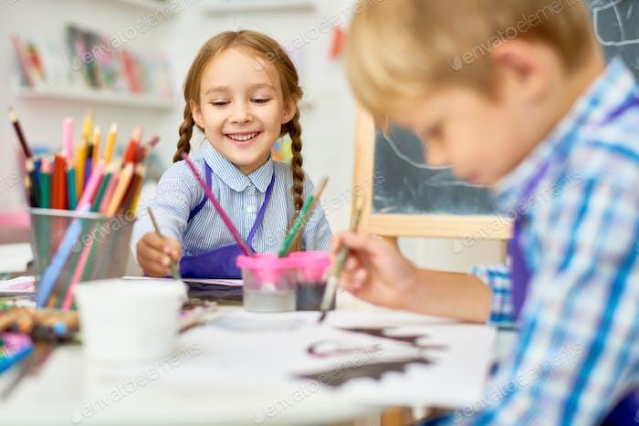 Happy Children Painting in Art Class