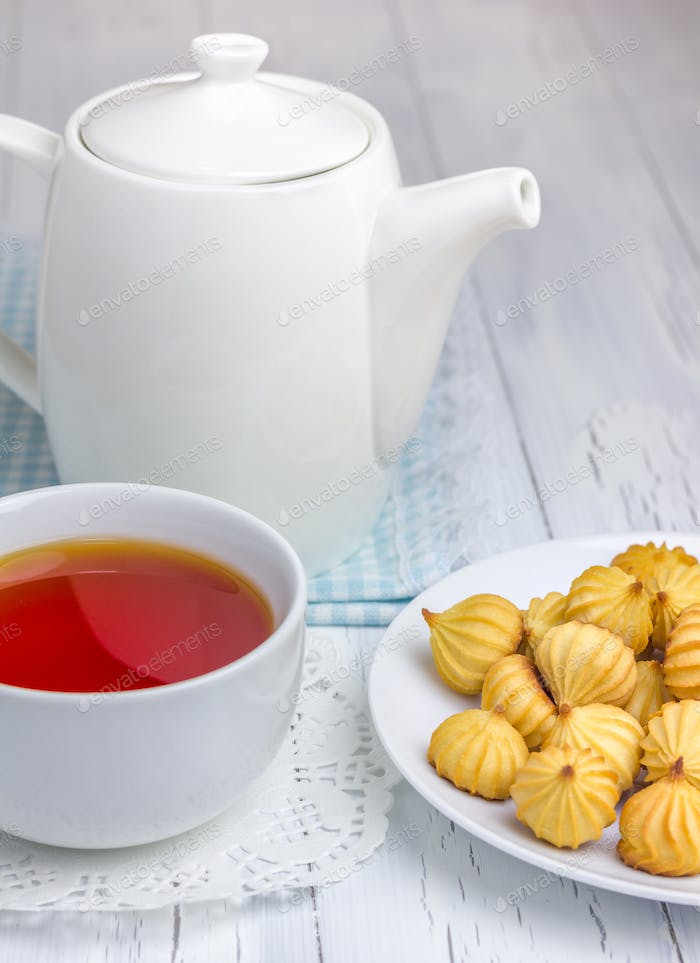 A cup of redbush tea with tiny shortbread cookies